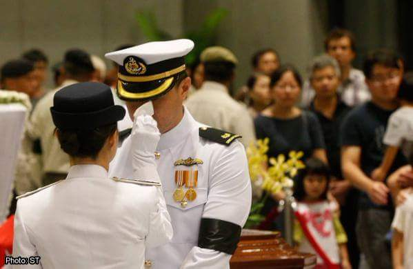 Touching Scene: A lady officer was wiping the tears for a Vigil GuardPhoto Credit: Straits Time